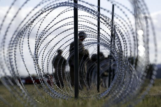 (AP Photo/Eric Gay, File). FILE--In this Nov. 3, 2018, file photo, members of the U.S. Army build a razor wire fence around area for tents near the U.S.-Mexico International bridge, in Donna, Texas. The U.S. government is working to open two new large ...