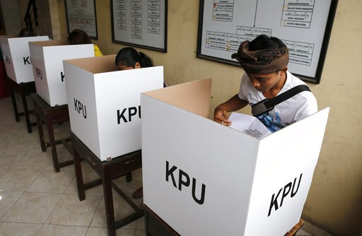 (AP Photo/Firdia Lisnawati). People cast their ballots during presidential and legislative elections in Bali, Indonesia, Wednesday, April 17, 2019. About 193 million people are eligible to vote in polls that will decide who leads the world's most popul...