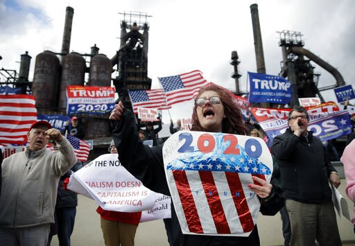 (AP Photo/Matt Rourke). Protesters demonstrate in support of President Donald Trump near a Fox News town-hall style event with U.S. Sen. Bernie Sanders, Monday, April 15, 2019, in Bethlehem, Pa.