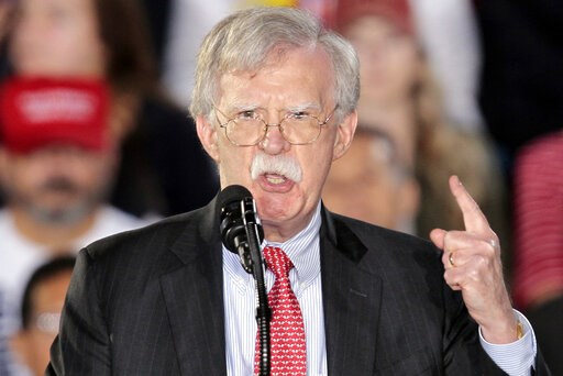(AP Photo/Luis M. Alvarez, File). FILE - In this Feb. 18, 2019, file photo, national security adviser John Bolton speaks to the Venezuelan American community in Miami. The Trump administration is poised to step up pressure on Cuba by allowing lawsuits ...