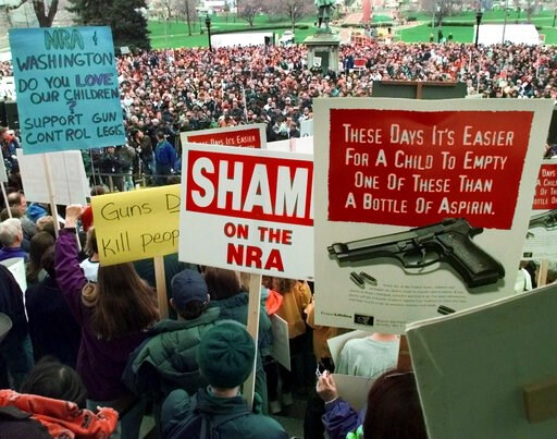 (AP Photo/Eric Gay, File). FILE - In this May 1, 1999, file photo, demonstrators gather on the Colorado State Capitol grounds in Denver, Colo., to protest against the National Rifle Association's annual meeting, which is being held in the city. Data sh...
