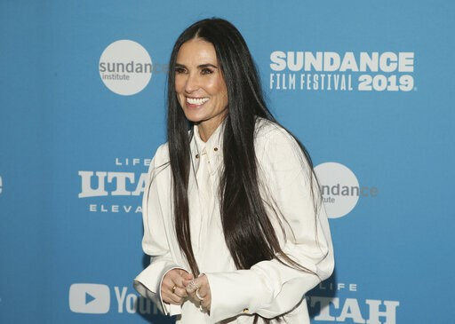 "(Photo by Danny Moloshok/Invision/AP, File). FILE - In this Tuesday, Jan. 29, 2019 file photo, actress Demi Moore poses at the premiere of the film ""Corporate Animals"" during the 2019 Sundance Film Festival, in Park City, Utah. Nine years after her boo..."
