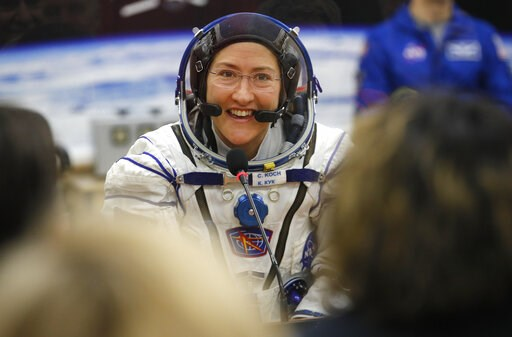 (AP Photo/Dmitri Lovetsky, Pool). FILE - In this Thursday, March 14, 2019 file photo, U.S. astronaut Christina Koch, member of the main crew of the expedition to the International Space Station (ISS), speaks with her relatives through a safety glass pr...