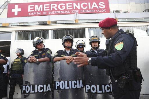(AP Photo/Martin Mejia). Peru's police officers stand guard at the emergency hospital Casimiro Ulloa where former Peruvian President Alan Garcia was taken after he shot himself in his neck, in Lima, Peru, Wednesday, April 17, 2019.   Garcia shot himsel...