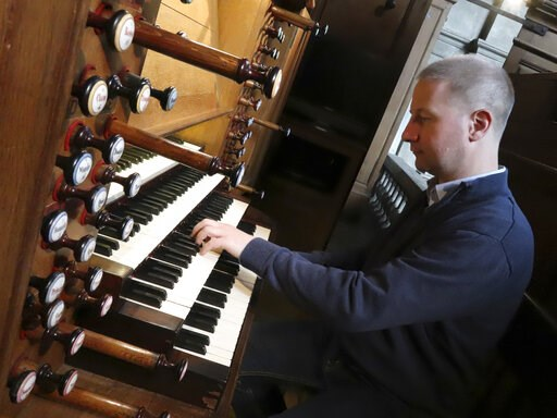 (AP Photo/Oleg Cetinic). Johann Vexo, the organist who was playing at evening mass inside Notre Dame when flames began licking at the iconic cathedral's roof, pllays the pipe organ at Notre Dame de Nancy cathedral, eastern France, Wednesday, April 17, ...
