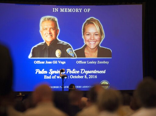 "(Mindy Schauer/The Orange County Register via AP, File). FILE - In this Oct. 18, 2016, file photo, images of slain Palm Springs, Calif., police officers Jose ""Gil"" Vega and Lesley Zerebny are displayed on a screen at the Palm Springs Convention Center ..."