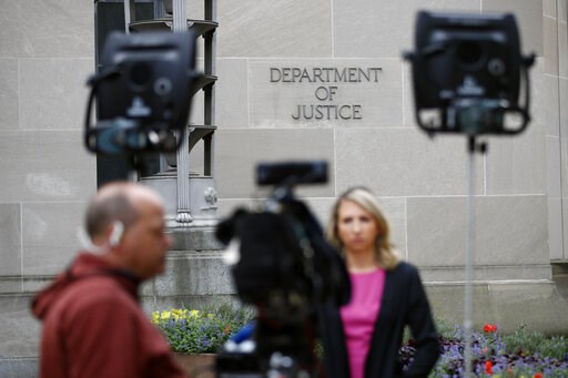 (AP Photo/Patrick Semansky). A television news crew works outside the Department of Justice building Wednesday, April 17, 2019, in Washington.