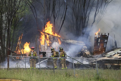 (Tom Reel/The San Antonio Express-News via AP). Firefighters work to control a fire at a home in San Antonio, Texas, involving SWAT team members on April 16, 2019. Authorities in San Antonio say a man assaulted his wife, fatally shot a neighbor and set...