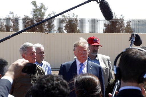 (AP Photo/Jacquelyn Martin, File). FILE - In this April 5, 2019, file photo, President Donald Trump visits a new section of the border wall with Mexico in Calexico, Calif. When Trump insisted last year that the border was in crisis, his warnings landed...