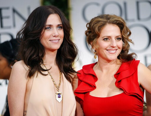 "(AP Photo/Chris Pizzello, File). FILE - This Jan. 15, 2012 file photo shows Kristen Wiig, left, and Annie Mumolo at the 69th Annual Golden Globe Awards in Los Angeles. ""Bridesmaids"" writers Wiig and Mumolo are reuniting, eight years after their smash h..."
