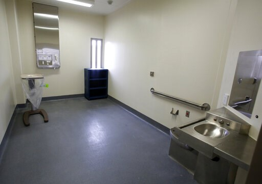 (AP Photo/Rich Pedroncelli, File). FILE - This Tuesday, June 25, 2013 file photo shows a secure patient treatment room in a housing unit at the California Correctional Health Care Facility in Stockton, Calif., during dedication day festivities. Legionn...