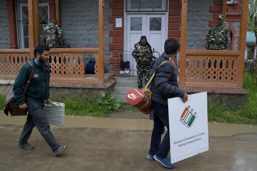 (AP Photo/Dar Yasin). Kashmiri polling officials carry electronic voting machines and other election material on the eve of the second phase of India's general election outside a distribution center in Srinagar, Indian controlled Kashmir, Wednesday, Ap...