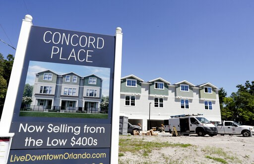(AP Photo/John Raoux). In this Tuesday, April 16, 2019, photo, new town homes under construction are being built in vacant lots in a neighborhood near downtown Orlando, Fla. The U.S. Census Bureau said Thursday, April 18 that Orlando grew by 60,000 peo...