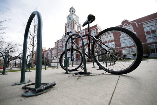 "(AP Photo/David Zalubowski). A lone bicycle stands in the rack outside East High School, Wednesday, April 17, 2019, in Denver. Denver-area public schools closed Wednesday as the FBI hunted for an armed young Florida woman who was allegedly ""infatuated""..."