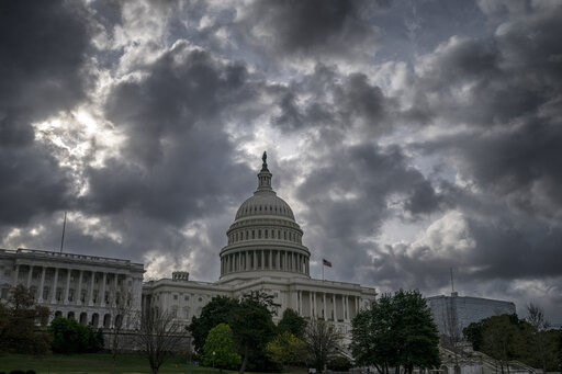 (AP Photo/J. Scott Applewhite, File). FILE - In this April 12, 2019, file photo morning clouds cover Capitol Hill in Washington. On Thursday, April 18, the Labor Department reports on the number of people who applied for unemployment benefits last week.