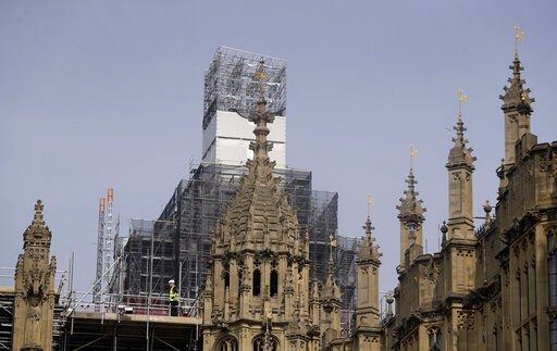 (AP Photo/Kirsty Wigglesworth). In this photo taken on Wednesday, April 17, 2019, Britain's Houses of Parliament, covered in hoarding and scaffolding as it undergoes restoration work to repair the crumbling building, in London. For some Britons who wat...