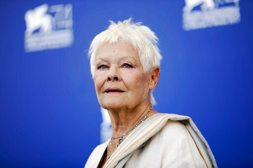 "(AP Photo/Domenico Stinellis, file). FILE - In this Sunday, Sept. 3, 2017 file photo, actress Judi Dench poses during a photo call for the film ""Victoria And Abdul"" at the 74th Venice Film Festival in Venice, Italy. Judi Dench is back in the world of e..."
