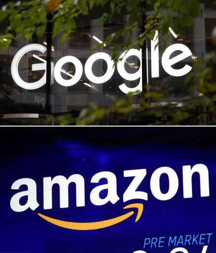 (AP Photo). This combo of photo shows the Google logo at their offices in Granary Square, London on Nov. 1, 2018, top, and the Amazon logo on a screen at the Nasdaq MarketSite in New York's Times Square on Oct. 3, 2018, bottom. Amazon and Google are en...