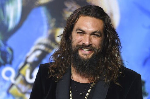 "(Photo by Jordan Strauss/Invision/AP, File). FILE - In this Dec. 12, 2018 file photo, Jason Momoa arrives at the premiere of ""Aquaman"" at TCL Chinese Theatre in Los Angeles. Momoa on Wednesday, April 17, 2019  released a video in which he shaved off hi..."