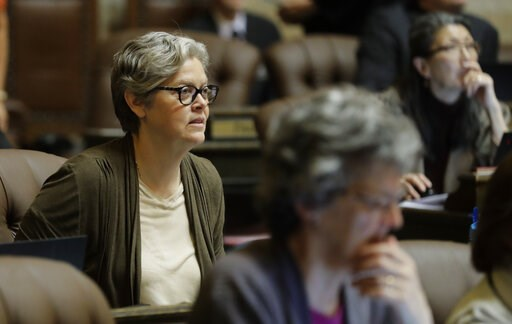 (AP Photo/Ted S. Warren). In this April 11, 2019 photo, Rep. Laurie Jinkins, D-Tacoma, listens to debate on the House floor at the Capitol in Olympia, Wash. Jinkins is the sponsor of a measure that has Washington poised to become the first state to est...