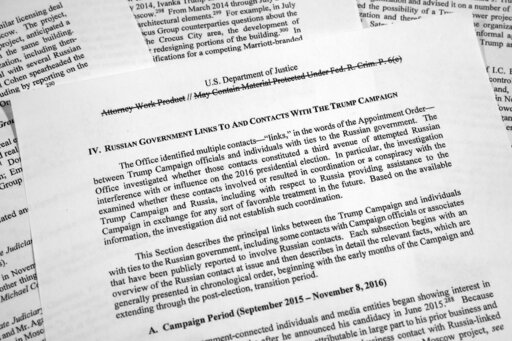 (AP Photo/Jon Elswick). Special counsel Robert Mueller's redacted report on Russian interference in the 2016 presidential election as released on Thursday, April 18, 2019, is photographed in Washington. The section discusses Russian government links an...