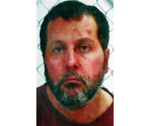 (FBI via AP, File). FILE - This undated file photo released by the FBI, shows Amor Ftouhi. Federal prosecutors are seeking a life sentence for the Tunisian native from Canada who was convicted of terrorism for nearly killing a Michigan airport police o...
