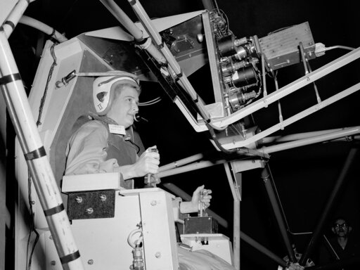 (NASA via AP). In this 1960 photo made available by NASA, Jerrie Cobb prepares to operate the Multi-Axis Space Test Inertia Facility (MASTIF) at the Lewis Research Center in Ohio.  The three-axis rig was developed to train Project Mercury pilots in bri...