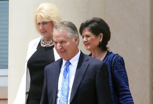 (Jean Gordon/Daily Courier via AP, File). FILE - In this  July 2017, file photo, Kent Covington, front, his wife, Brooke, left, and a fellow member of the Word of Faith Fellowship church, Jayne Caulder, walk from the Rutherford County Courthouse in Rut...
