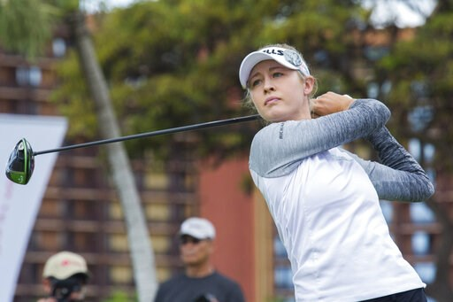 (Craig T. Kojima/Honolulu Star-Advertiser via AP). In this photo taken Wednesday, April 17, 2019, Nelly Korda follows her drive from the first tee of Ko Olina Golf Club during the first round of the Lotte Championship golf tournament in Kapolei, Hawaii.