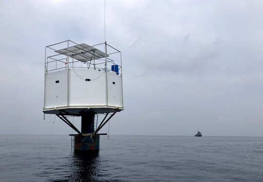 (Royal Thai Navy via AP). This Saturday, April 13, 2019, photo provided by Royal Thai Navy, shows a floating home lived in by an American man and his Thai partner in the Andaman Sea, off Phuket island, Thailand. Thai authorities raided Thursday, April ...