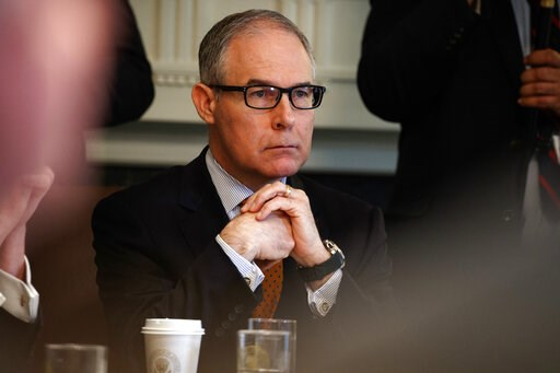 (AP Photo/Evan Vucci, File). FILE - In this June 21, 2018, file photo, Environmental Protection Agency administrator Scott Pruitt listens during a cabinet meeting at the White House in Washington. Pruitt, the scandal-ridden former head of the Environme...