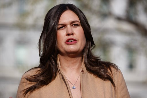 (AP Photo/Evan Vucci, File). FILE - In this April 4, 2019, file photo, White House press secretary Sarah Sanders talks with reporters outside the White House in Washington.