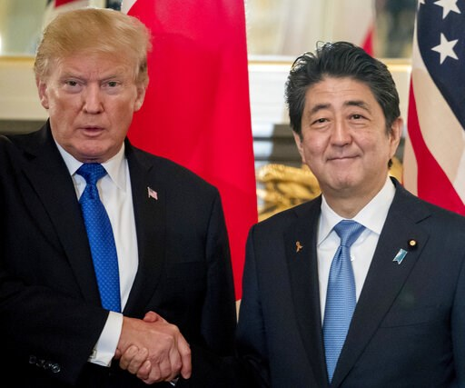 (AP Photo/Andrew Harnik, File). FILE - In this Nov. 6, 2017, file photo, U.S. President Donald Trump, left, and Japanese Prime Minister Shinzo Abe shake hands before a bilateral meeting at the Akasaka Palace in Tokyo. Trump will make a state visit to J...