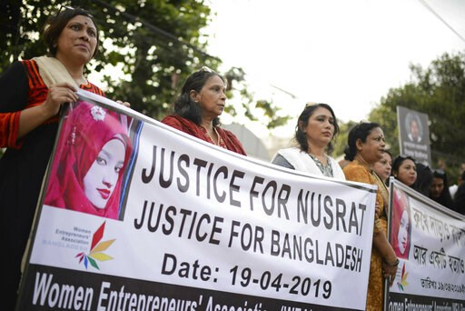 (AP Photo/Mahmud Hossain Opu). Protesters hold placards and gather to demand justice for an 18-year-old woman who was killed after she was set on fire for refusing to drop sexual harassment charges against her Islamic school's principal, in Dhaka, Bang...
