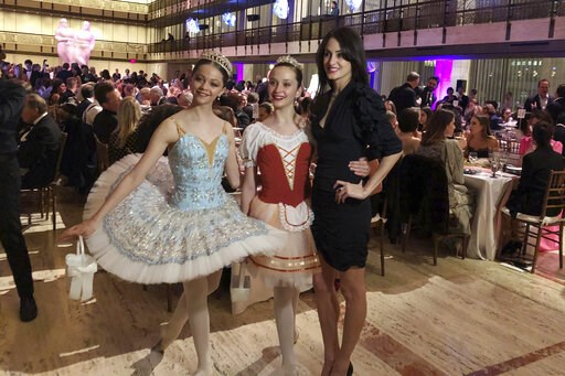 "(AP Photo/Jocelyn Noveck). Choreographer Melanie Hamrick poses with dancers at the gala of Youth America Grand Prix, the world's largest ballet scholarship competition, on Thursday, April 18, after the U.S. premiere of her new ballet, ""Porte Rouge"" (Re..."