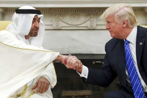 (AP Photo/Andrew Harnik, File). FILE - In this May 15, 2017, file photo, President Donald Trump shakes hands with Abu Dhabi's crown prince, Sheikh Mohammed bin Zayed Al Nahyan, in the White House in Washington. Sheikh Mohammed, one of the most-powerful...