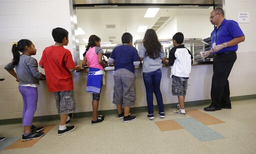 (AP Photo/Eric Gay, File). FILE - In this Sept. 10, 2014, file photo, detained immigrant children line up in the cafeteria at the Karnes County Residential Center, a detention center for immigrant families, in Karnes City, Texas. The Trump administrati...