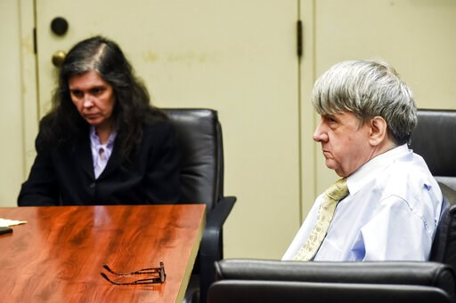 (Watchara Phomicinda/The Orange County Register/SCNG via AP, Pool, File). FILE - In this Aug. 3, 2018 file photo, Louise Turpin, left, and her husband, David Turpin appear in Superior Court in Riverside, Calif. The Turpins, who starved a dozen of their...