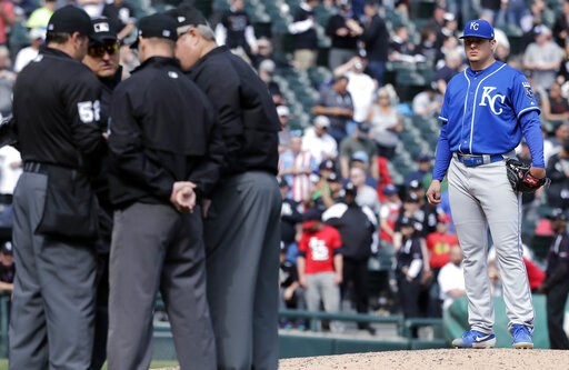 (AP Photo/Nam Y. Huh). Kansas City Royals starting pitcher Brad Keller, right, looks at the umpires after Chicago White Sox's Tim Anderson was hit by a pitch by him as benches cleared during the sixth inning of a baseball game in Chicago, Wednesday, Ap...