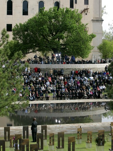(AP Photo/Sue Ogrocki, File). FILE - In this April 19, 2010 file photo, people gather under the Survivor Tree at the Oklahoma City National Memorial during a ceremony marking the 15th anniversary of the Oklahoma City bombing. As part of the city's annu...