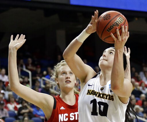 (AP Photo/Gerry Broome, File). FILE - In this March 30, 2019, file photo, Iowa's Megan Gustafson (10) shoots against North Carolina State's Elissa Cunane (33) during the second half of a regional women's college basketball game in the NCAA Tournament i...