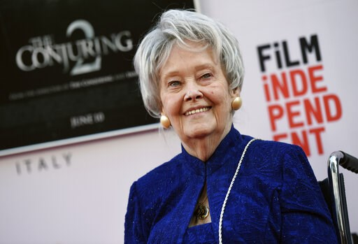 "(Photo by Chris Pizzello/Invision/AP, File). FILE - In this June 7, 2016, file photo, paranormal investigator and film consultant Lorraine Warren poses at the premiere of the film ""The Conjuring 2"" during the Los Angeles Film Festival at the TCL Chines..."