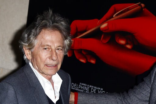 "(AP Photo/Francois Mori, File). FILE - In this Oct. 30, 3017 file photo director Roman Polanski poses a photo  prior to the screening of ""Based on a true story"" in Paris, France. Roman Polanski is asking a judge to restore his membership in the Academy..."