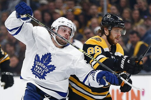 (AP Photo/Michael Dwyer). Boston Bruins' David Pastrnak (88) defends against Toronto Maple Leafs' Auston Matthews during the first period in Game 5 of an NHL hockey first-round playoff series in Boston, Friday, April 19, 2019.