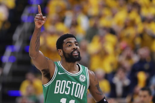 (AP Photo/Darron Cummings). Boston Celtics guard Kyrie Irving gestures during the first half of Game 3 of the team's NBA basketball first-round playoff series against the Indiana Pacers, Friday, April 19, 2019, in Indianapolis.
