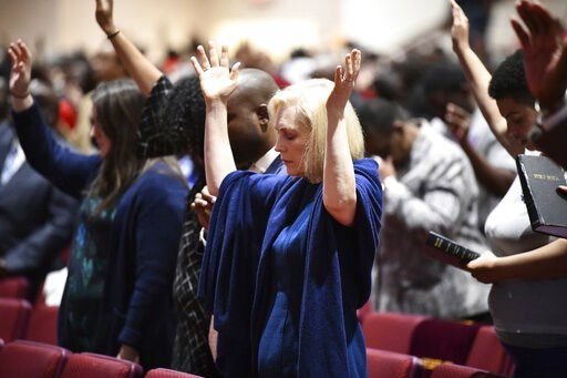 (AP Photo/Meg Kinnard, File). FILE - In this Feb. 10, 2019, file photo, Sen. Kirsten Gillibrand, D-N.Y., worships at Mount Moriah Missionary Baptist Church in North Charleston, S.C. By now, most Democratic presidential candidates have polished their st...