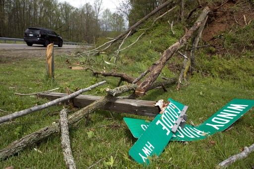 (Heather Rousseau/The Roanoke Times via AP). Fallen trees and street signs litter the grass off Highway 220 North after a tornado touched down in Franklin County, Va., Friday, April 19, 2019.