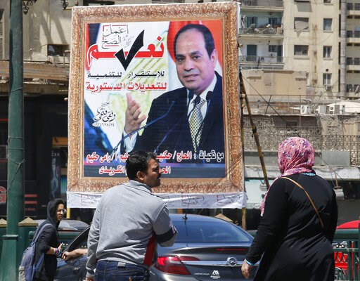 (AP Photo/Amr Nabil). People walk past a banner supporting proposed amendments to the Egyptian constitution with a poster of Egyptian President Abdel-Fattah el-Sissi in Cairo, Egypt, Tuesday, April 16, 2019. Egypt's parliament was holding its last deba...