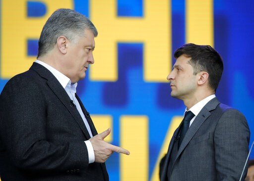 (AP Photo/Vadim Ghirda). Ukrainian presidential candidate and popular comedian Volodymyr Zelenskiy listens to Ukrainian President Petro Poroshenko during their final electoral campaign debate at the Olympic stadium in Kiev, Ukraine, Friday, April 19, 2...