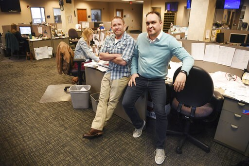 (Briana Sanchez/The Argus Leader via AP). In this April 9, 2019, photo, Argus Leader investigative reporter Jonathan Ellis and news director Cory Myers in the newsroom in Sioux Falls, S.D. In 2010, reporters at South Dakota's Argus Leader newspaper cam...